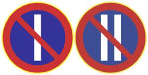 Kuvassa kaksi liikennemerkkiä. Vasennalla pysäköinti kielletty parittomina päivinä liikennemerkki. Oikealla pysäköinti kielletty parillisina päivinä liikennemerkki.