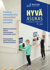 Hyvä asukas -lehden uusimman numeron kannessa on kaksi poikaa palauttamassa kirjoja Virran uusilla kosketusnäytöllisillä palautusautomaateilla.